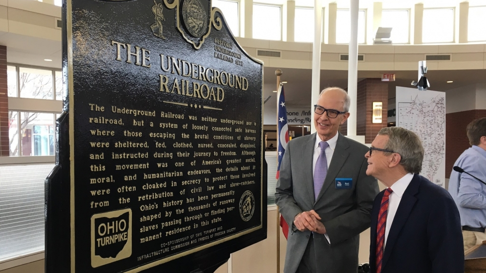 Burt Logan, CEO of Ohio History Connection (left) and Ohio Governor Mike DeWine admire the Underground Railroad Historical Plaque in Clyde.