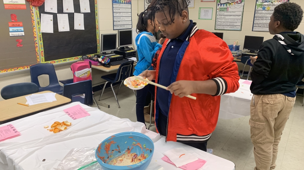 Nar'Velle, a student in Mrs. Simpson's class at Marion Sterling Elementary in Cleveland goes back for seconds after making a healthy Waldorf salad snack.
