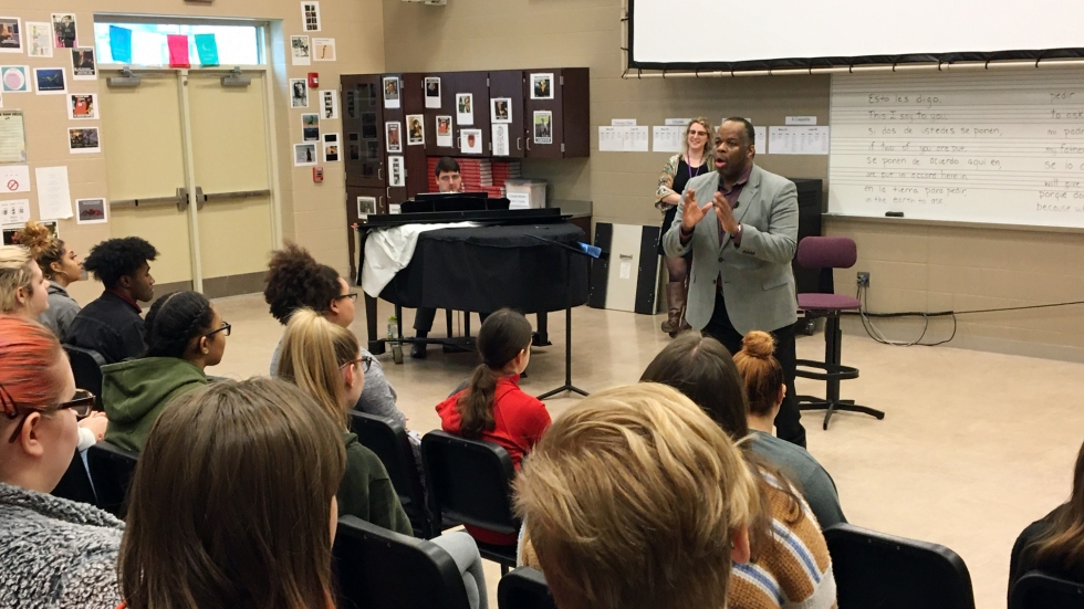 Opera singer Lester Lynch works with choir students at Elyria High School.