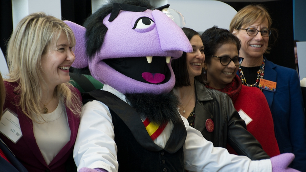 Sesame Street's the Count poses with attendees at a U.S. Census Bureau event in Cleveland.