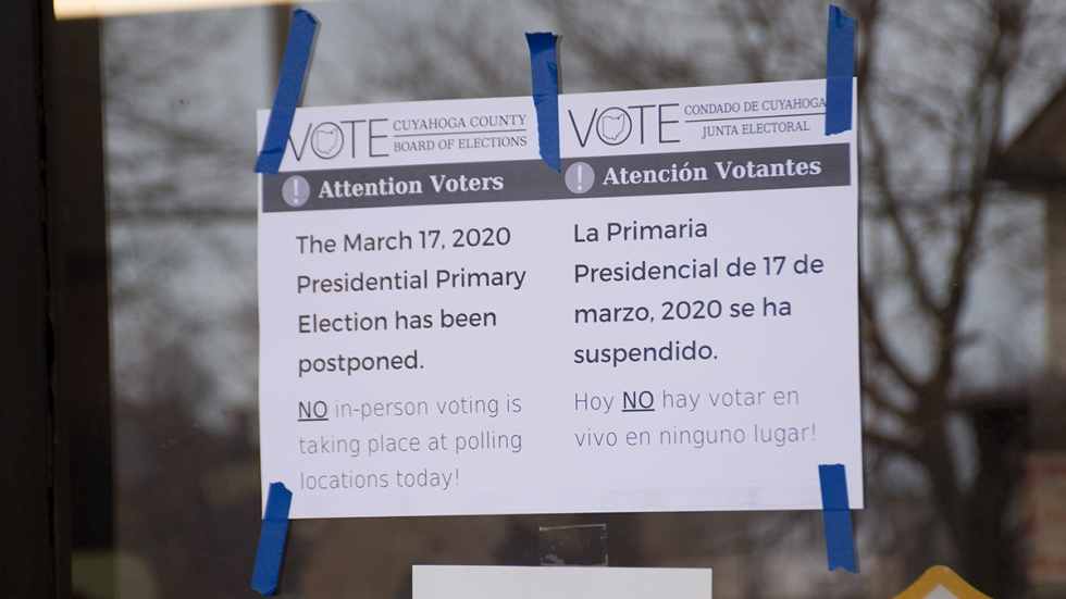A sign notifying voters that polls are closed due to an order from the Ohio Department of Health