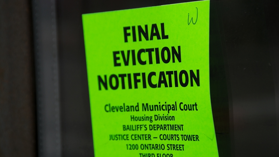 An eviction order posted at an apartment building in Cleveland's Detroit-Shoreway neighborhood. Court records show the move-out date has been rescheduled to April.