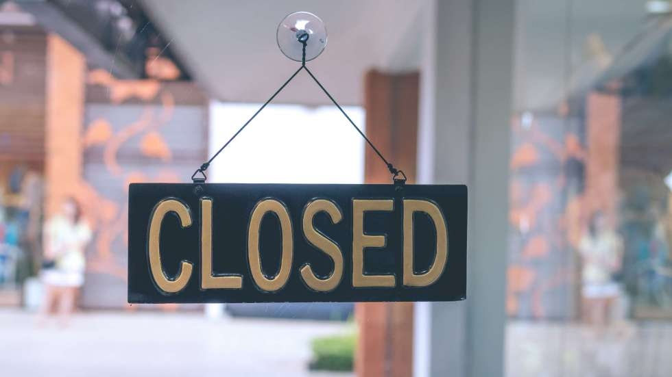 """A """"closed"""" sign in a restaurant window"""