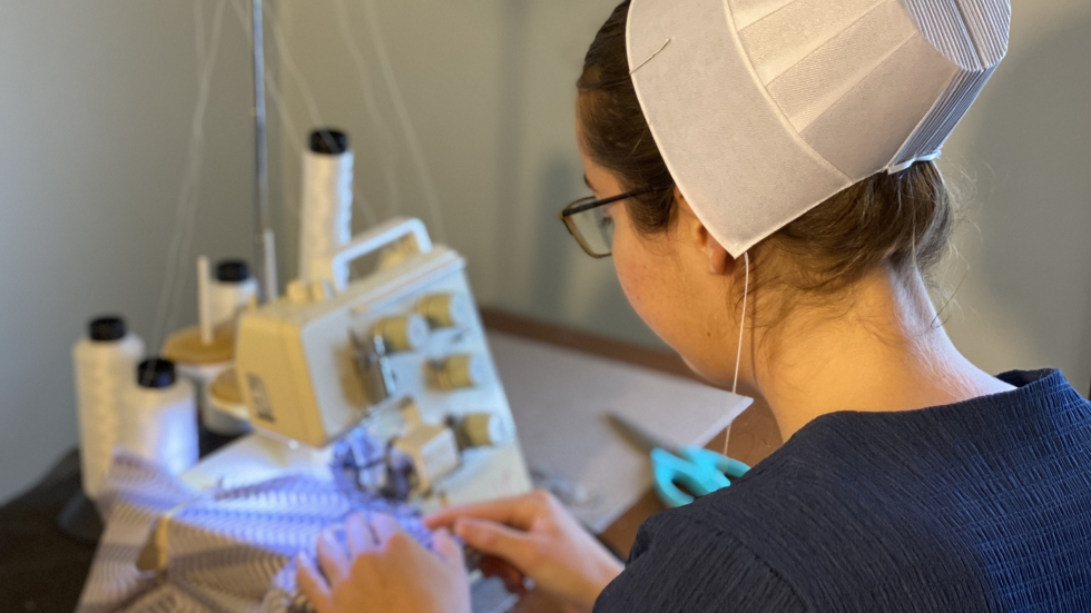 Hannah Troyer, an Amish woman from Walnut Creek, Ohio, is one of thousands who are making protective equipment to help respond to the coronavirus crisis.