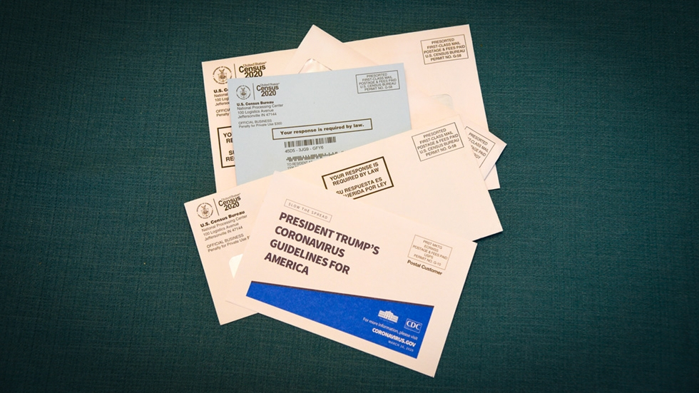 a pile of mail includes several notices from the U.S. Census Bureau and coronavirus guidance from President Donald Trump