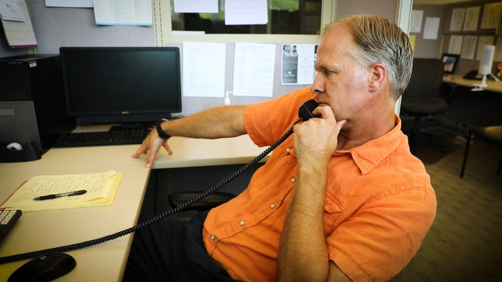 Frontline Service employee John Rudolph takes a call from the company's 24-7 crisis hotline. The mental health organization has received a slight uptick in calls during the COVID-19 crisis.