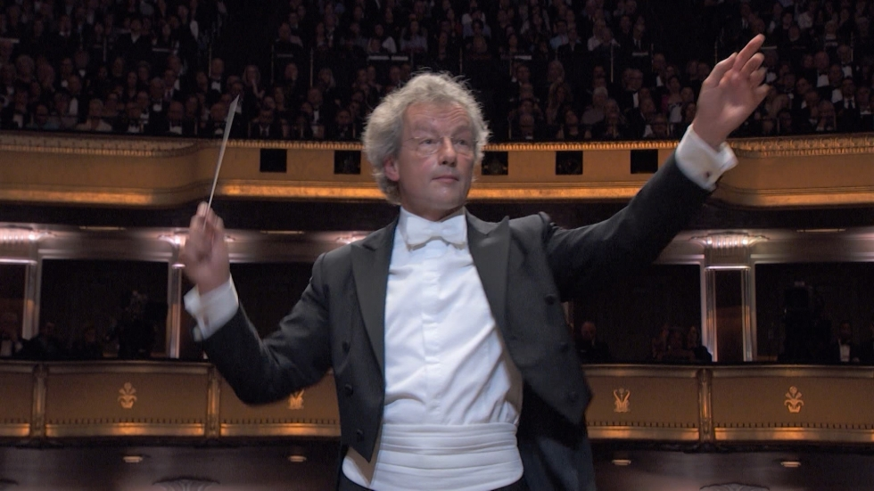 Franz Welser Most, arms raised, conducts the Cleveland Orchestra