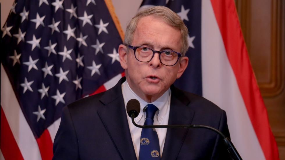 Ohio Gov. Mike DeWine (R), standing before the American flag and the flag of Ohio at a coronavirus briefing in Columbus on April 7, 2020.