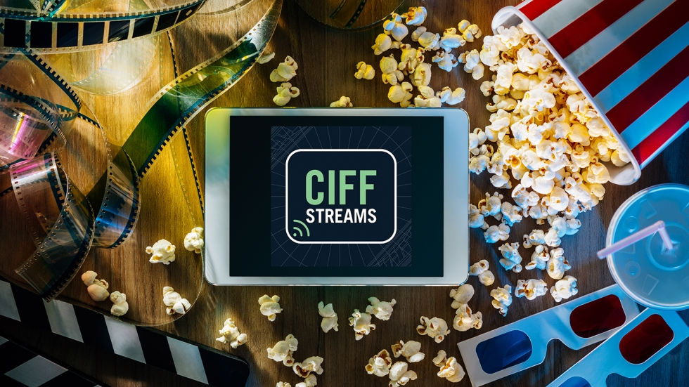 CIFF Streams logo on a tablet over a spilled box of popcorn, rolls of film and 3-D glasses.
