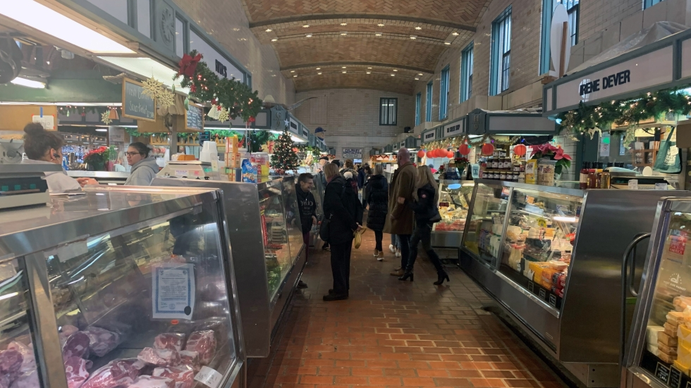 Shoppers walk between stalls at the West Side Market.