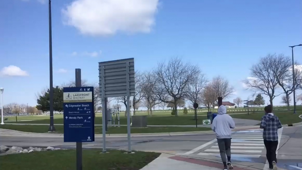 Two men run in Cleveland's Edgewater Park during the coronavirus crisis