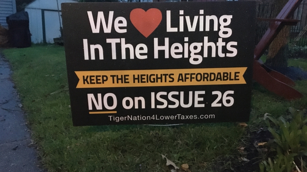 We love living in the Heights sign in front of a Cleveland Heights home.