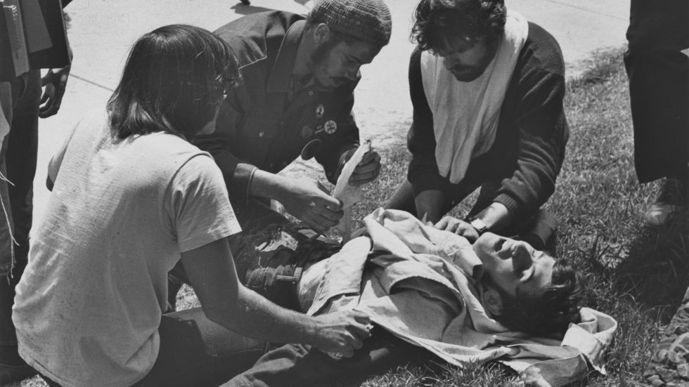 John Cleary on the ground after being shot by Ohio National Guard at Kent State University