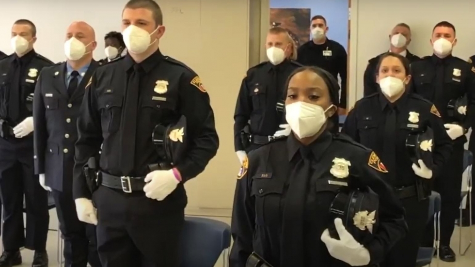 Cleveland police officers wear masks at a recent police academy graduation ceremony.