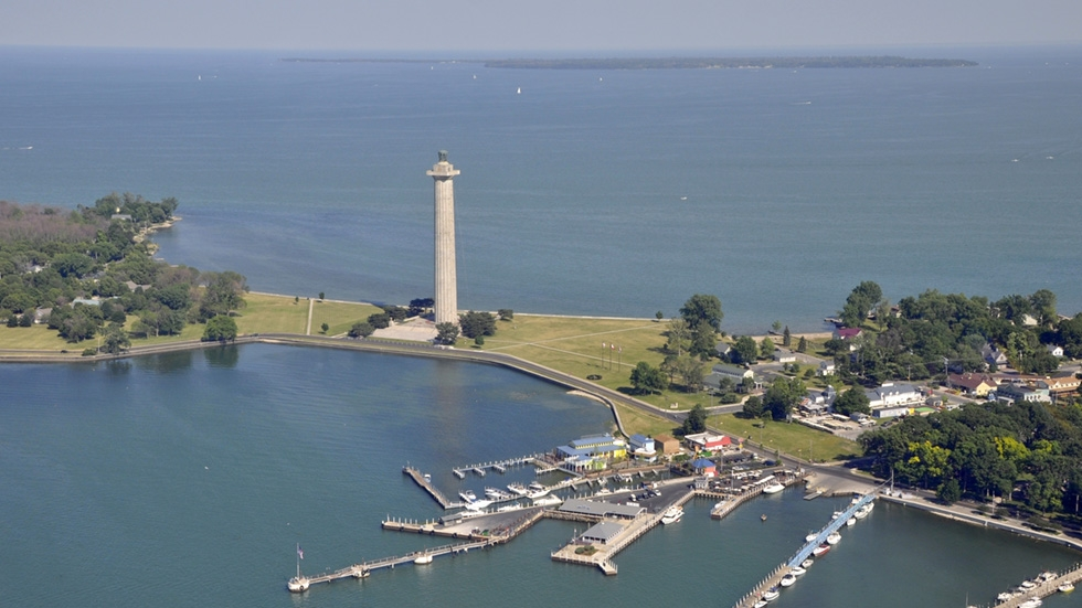 An aerial view of Put-in-Bay's marina and Perry's Victory and International Peace Memorial with Kelley's Island in the far background.