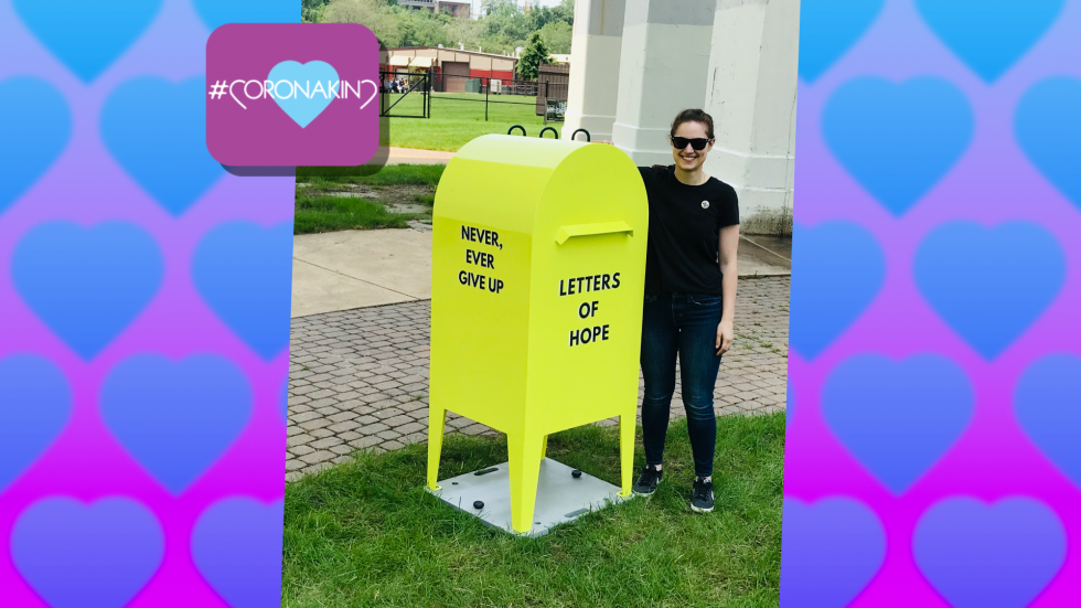 Allison Meyer, Never Ever Give Up Founder, is standing next to the yellow mailbox in Hart Crane Park after its debut.