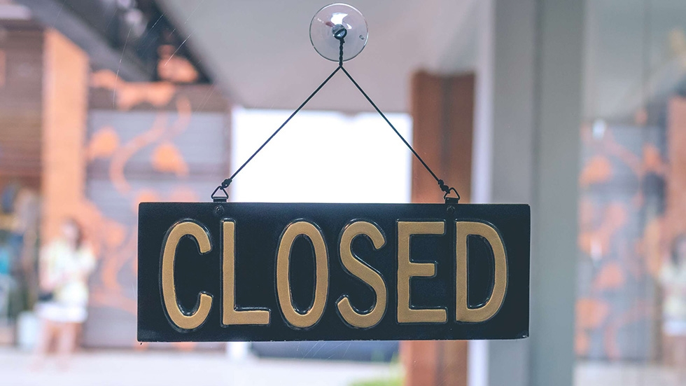 A closed sign in a store window