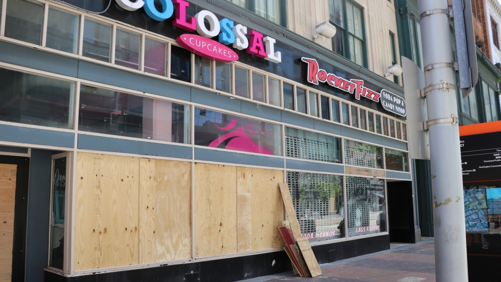 Boarded up exterior of Colossal Cupcakes on Euclid Ave at the 5th Street Arcade.