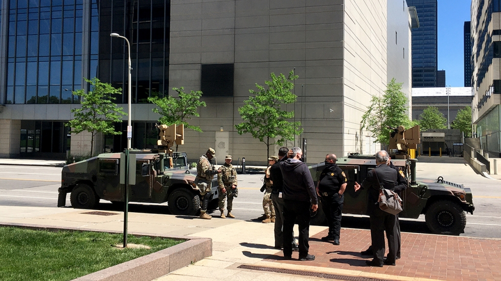 Cuyahoga County Sheriffs' Department staff and National Guard soldiers stand outside the Justice Center on Monday.