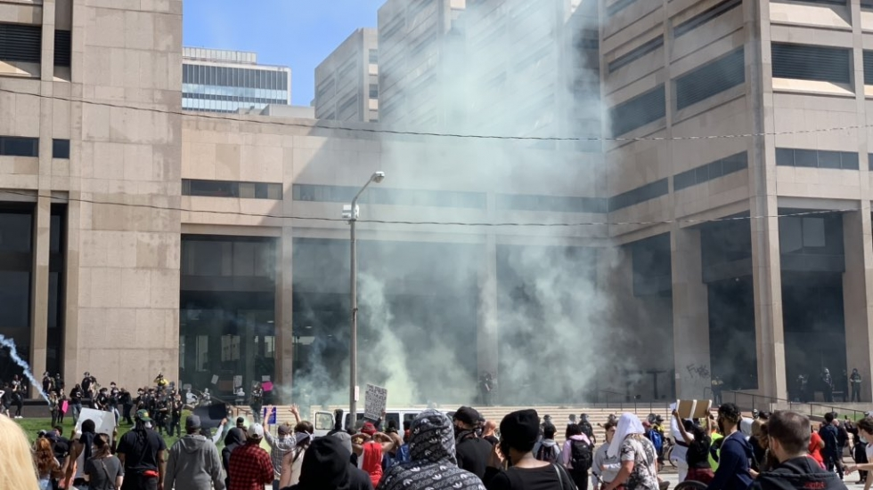 Cleveland police use tear gas to disperse a crowd of protesters in front of the Justice Center during protests May 30.
