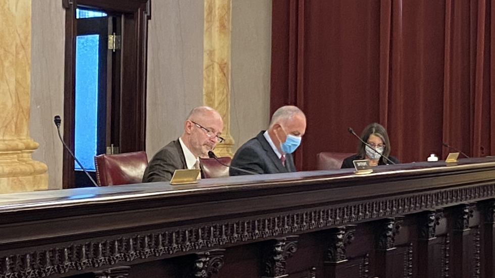 Ohio Senate Health, Human Services and Medicaid Committee co-chairmen Steve Huffman (R-Tipp City, left) and  Dave Burke (R-Marysville, right) in a hearing room.
