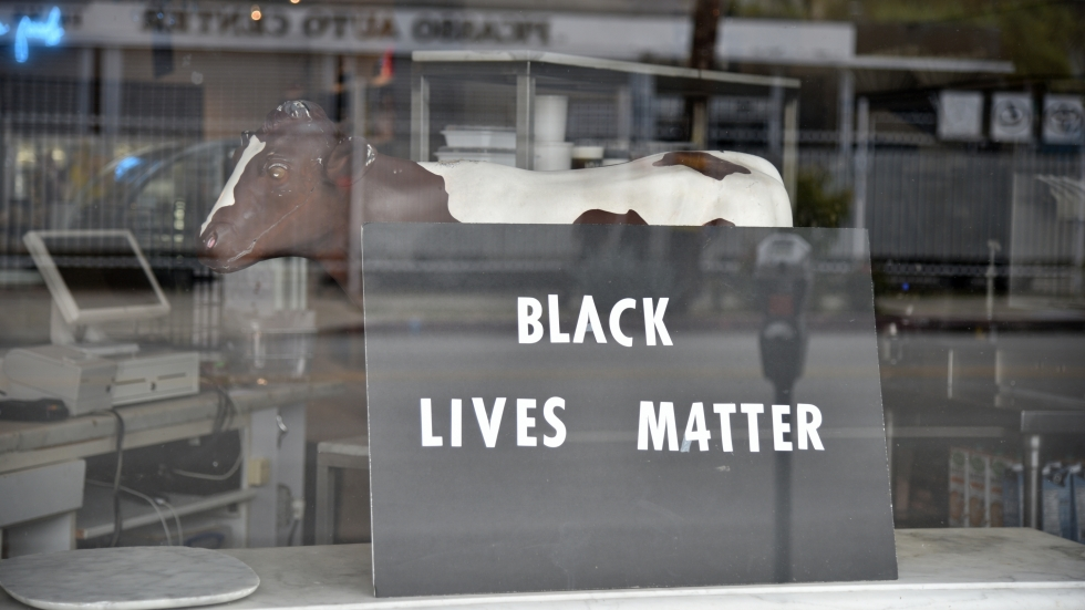 A Black Lives Matter sign in a store window in Los Angeles
