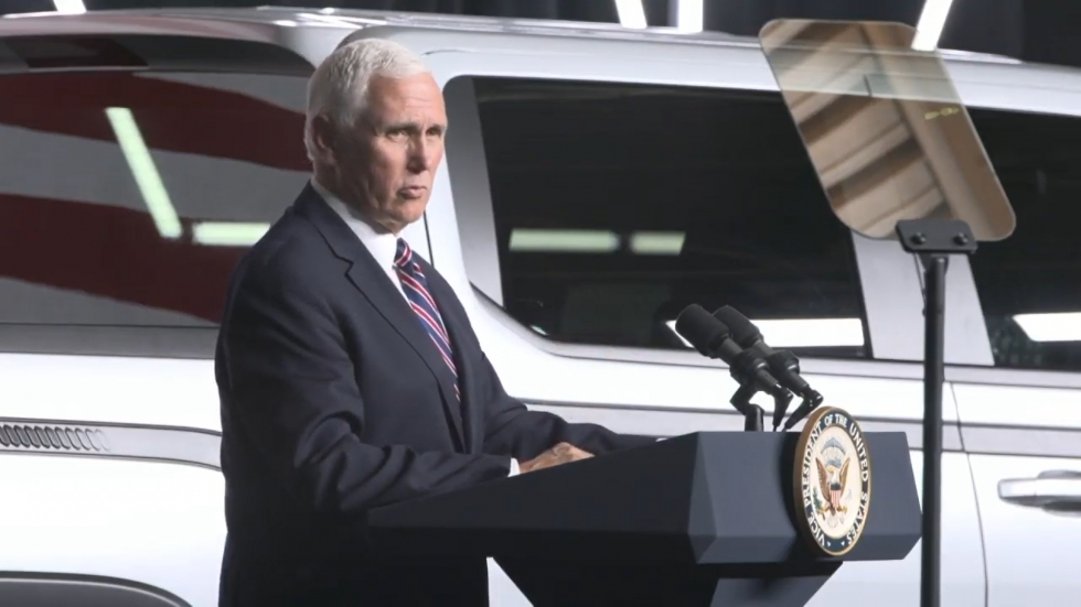Vice President Mike Pence standing at a podium beside the Endurance pickup truck.