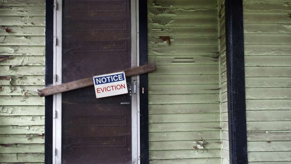 A closed door with an eviction notice attached