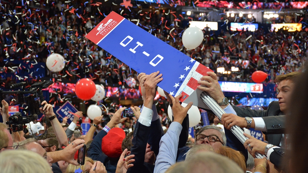 Ohio delegates take down a sign at the 2016 Republican National Convention in Cleveland.