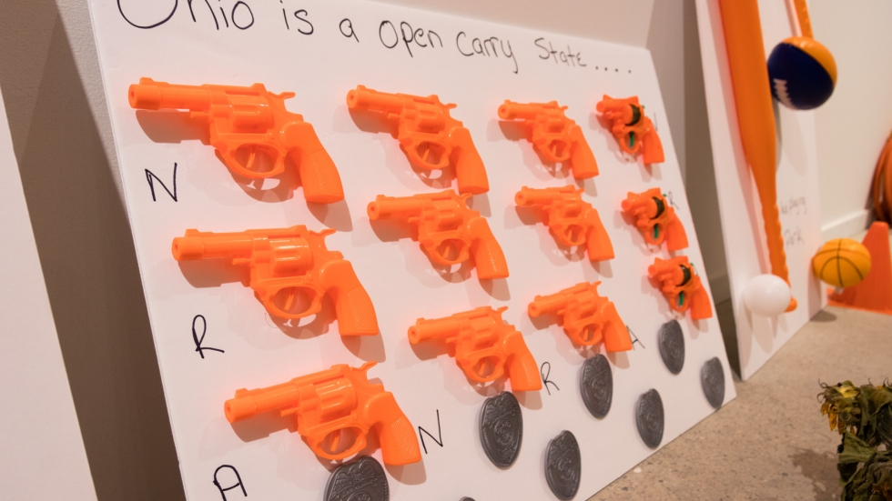 "A grid of orange plastic guns under the headline: ""Ohio is an open-carry state"""