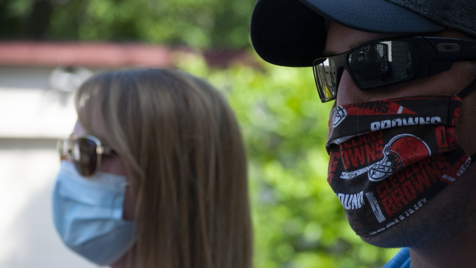 A woman and man wearing face masks.