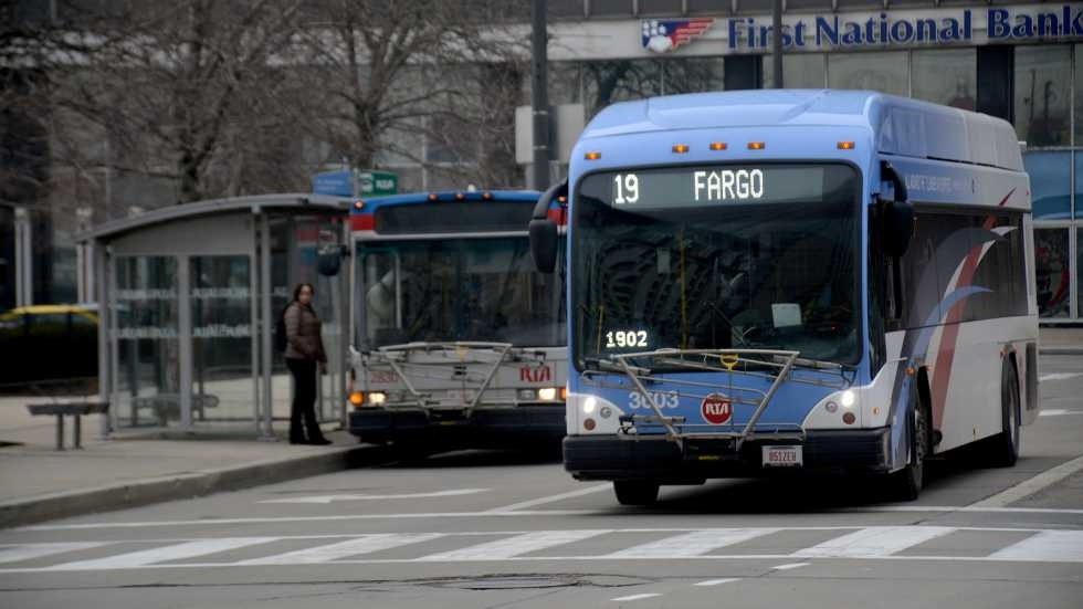 Two RTA buses driving through Downtown Cleveland.