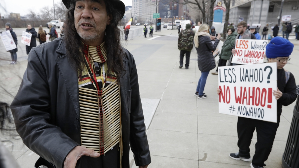 Philip Yenyo, executive director of the American Indian movement in Ohio, seen in this file photo from April 6, 2018 at a protest of Chief Wahoo before the Cleveland home opener Kansas City Royals and the Cleveland Indians. [Tony Dejak / AP]