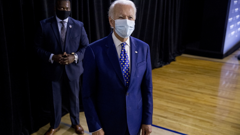 Democratic presidential candidate former Vice President Joe Biden on a stage in a mask