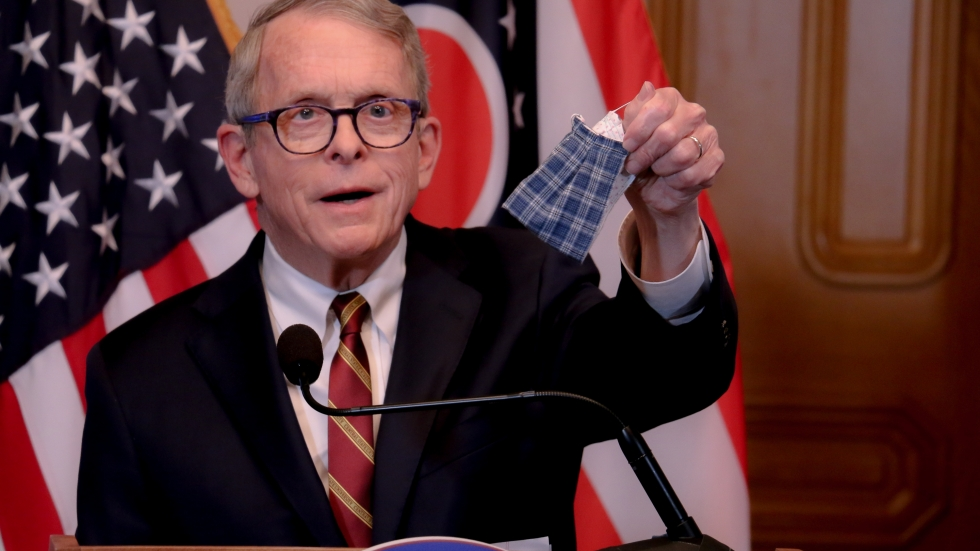 Gov. Mike DeWine holds up a face mask at a press conference April 6, 2020. [Office of Gov.  Mike DeWine]