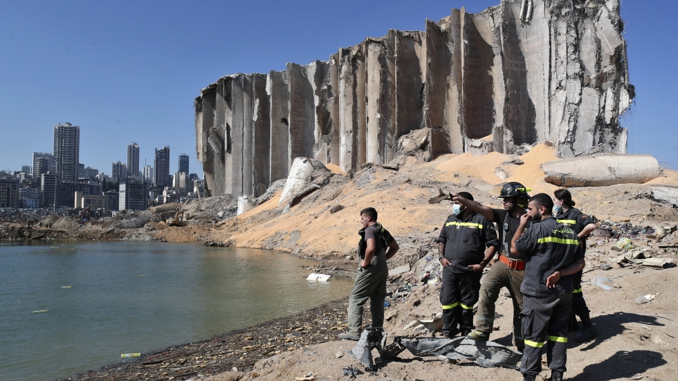 A rescue team surveys the site of this week's massive explosion in the port of Beirut, Lebanon, Friday.