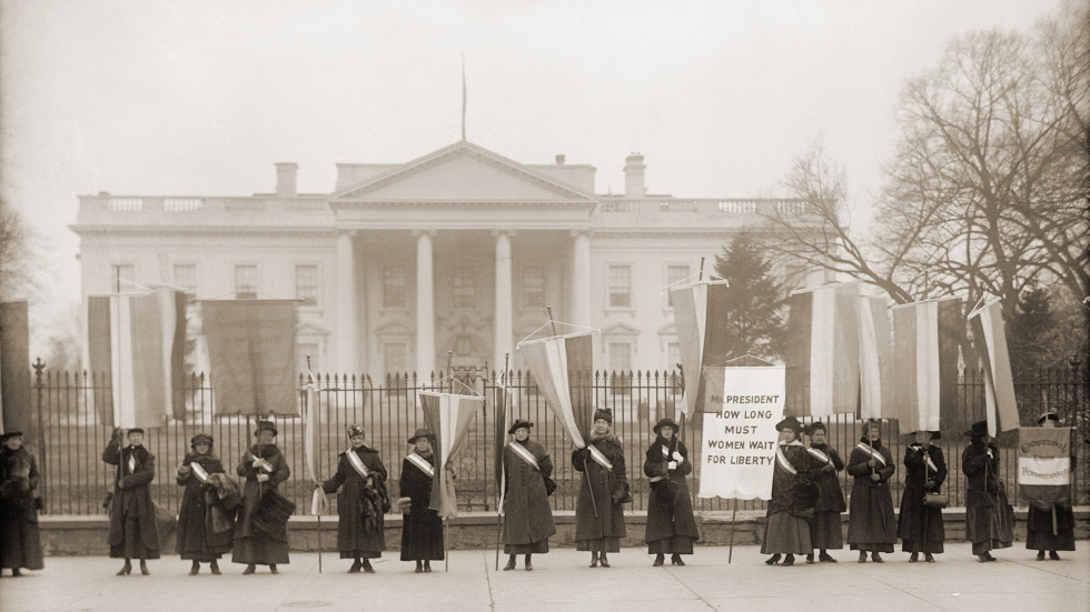 National Women's Party demonstration in front of the White House in 1918. The banner protests Wilson's failure to support women's suffrage. [Everett Collection / Shutterstock]