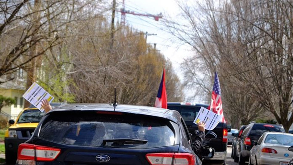 A caravan of cars drives through the Clark-Fulton neighborhood in Cleveland several months ago in an attempt to get the local Hispanic community registered to vote and counted in the 2020 U.S. Census.