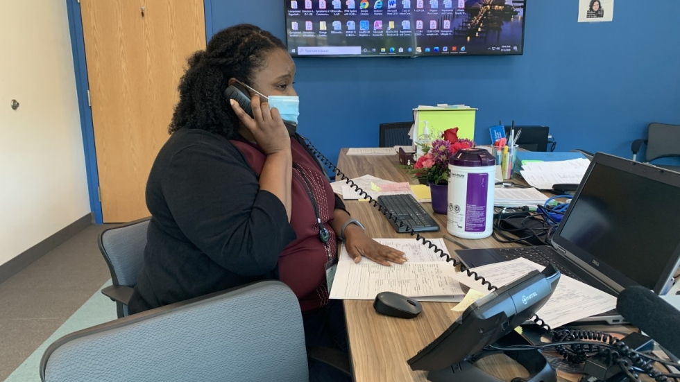 Dr. Amina Egwiekhor, a local physician and contact tracer for the Cuyahoga County Board of Health, calls a person who tested positive for the coronavirus to begin the contact tracing process on August 12, 2020. [Anna Huntsman / ideastream]