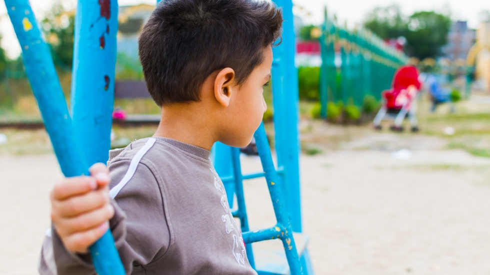 A child looking away on a playground