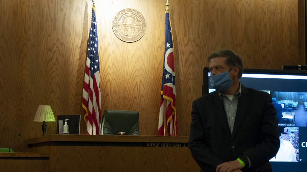 Administrative Judge Brendan Sheehan in a courtroom