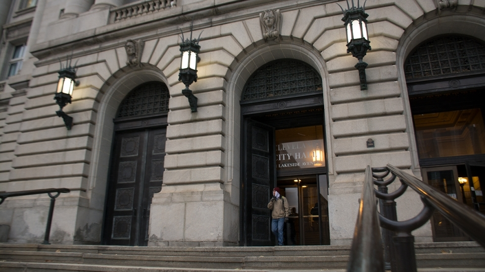 A man leaves Cleveland City Hall in December 2019.