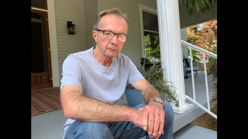 Ohio writer Donald Ray Pollock sits on the steps of his home in Chillicothe