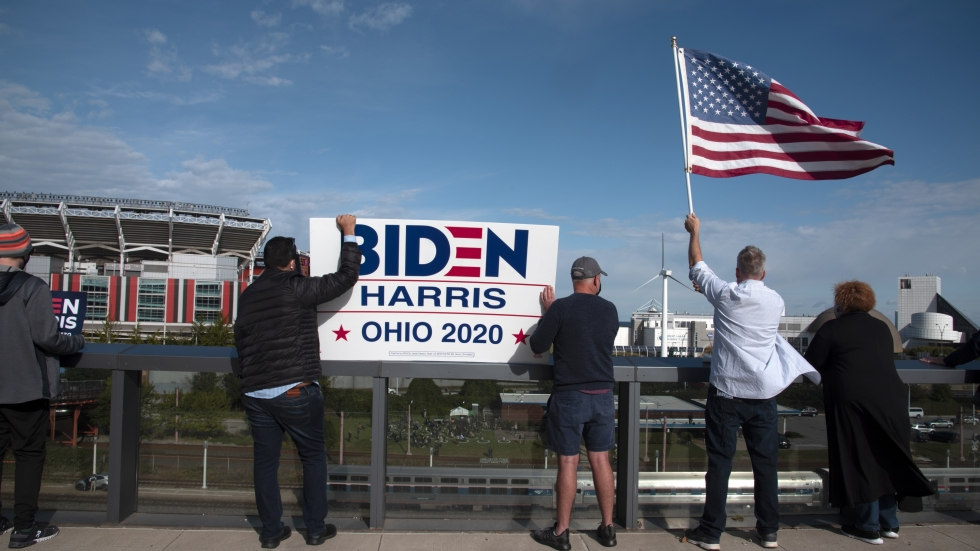 Biden supporters stand on an overpass above their candidate's train station rally in Downtown Cleveland.