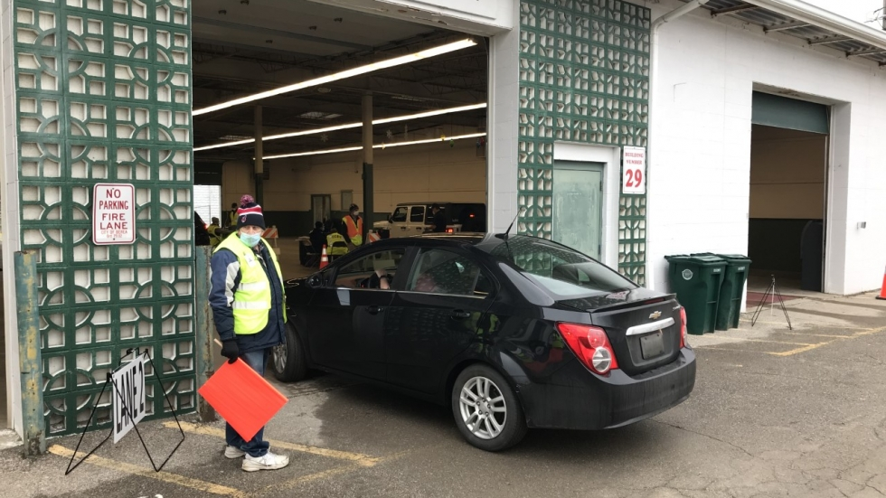 A person drives into a building at the Cuyahoga County Fairgrounds in Middleburg Heights where Cuyahoga County health board workers are administering COVID-19 vaccines to phase 1A priority groups Wednesday, Jan. 5, 2020.  County officials plan to hold vaccination clinics at community centers like the fairgrounds when more of the general public is eligible to receive the shots. [Kevin Brennan / Cuyahoga County Board of Health]