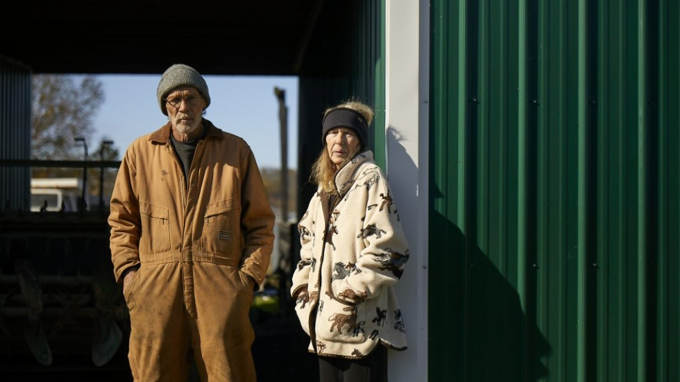 Kevin and Marlene Young stand outside their barn.