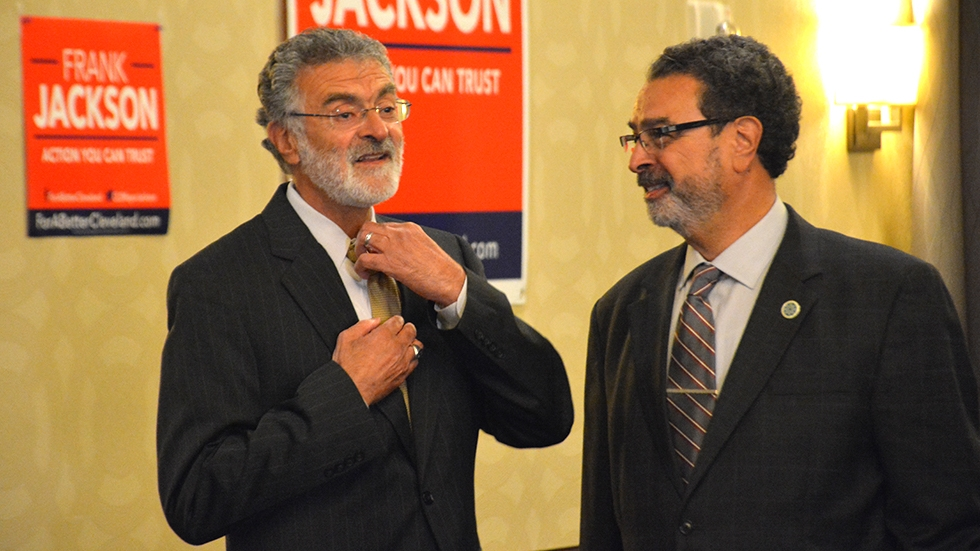 Cleveland Mayor Frank Jackson talks with his brother Anthony, right, during his election night watch party in 2017.