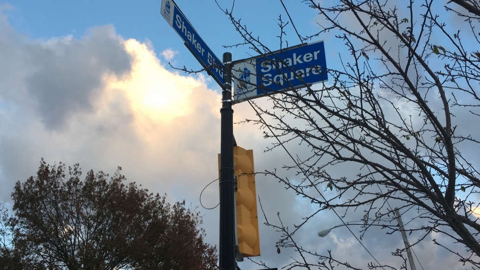 Sunlight peeks through the clouds behind a sign at the intersection of Shaker Boulevard in Cleveland's Shaker Square neighborhood.