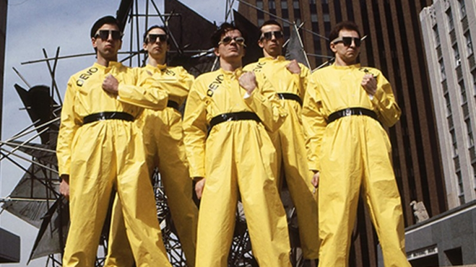 Members of DEVO in yellow hazmat suits posed for photographer Janet Macoska in various places around downtown Akron
