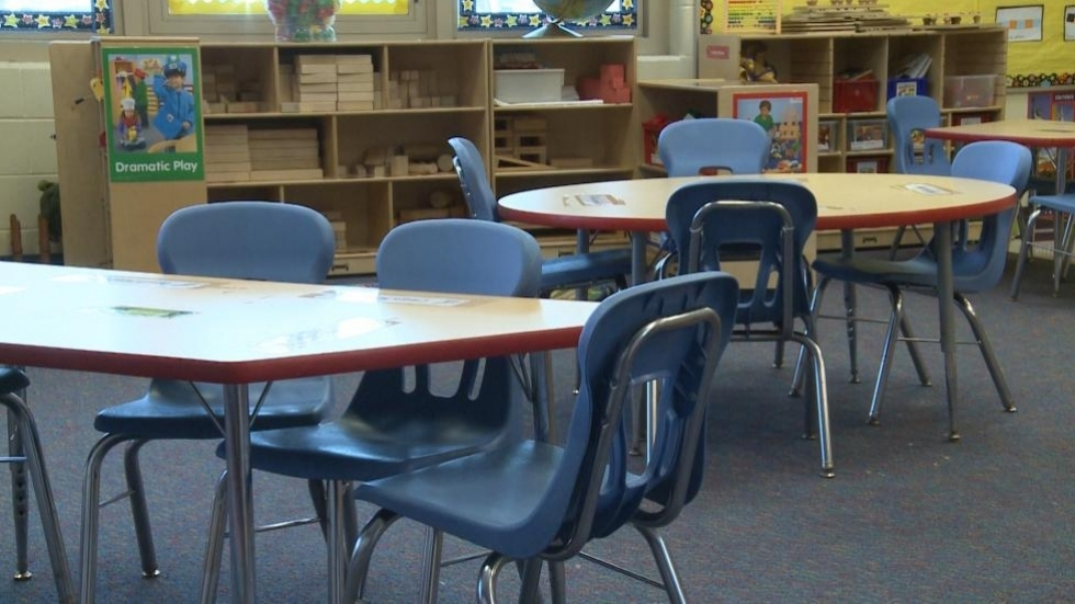 Empty chairs and tables in a pre-k classroom.